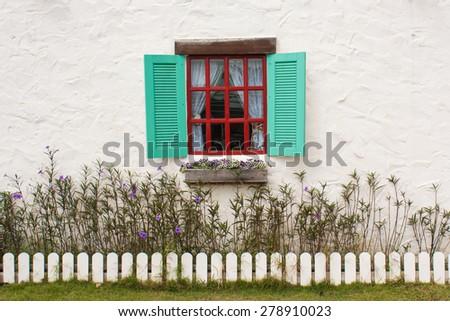 blue window in a white wall