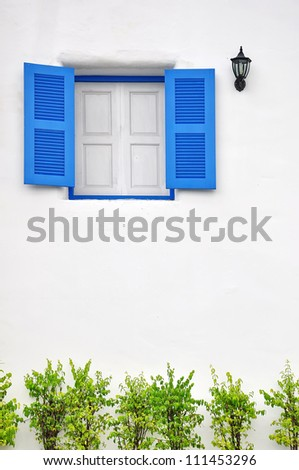Blue window on white wall