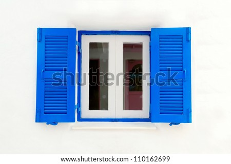 Blue window with white wall of official place.