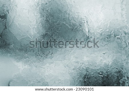 blue winter frosted window with beautiful tracery - stock photo