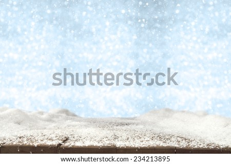 blue winter fuzzy background and snow on table
