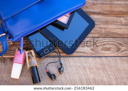 Blue women\'s purse. Things from open lady handbag.