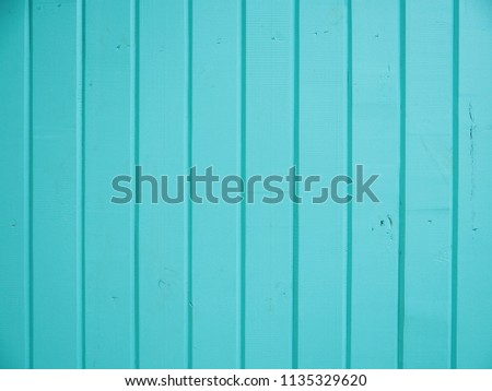 blue wooden background and green leaves