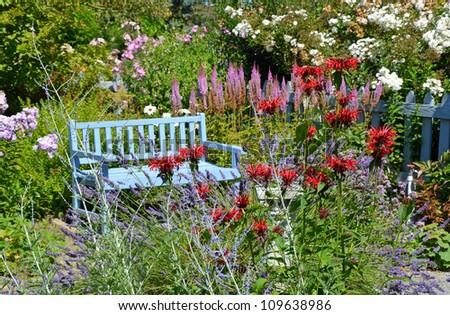 Blue wooden bench in garden background