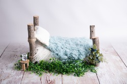 blue wooden log bed for newborns