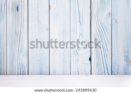 Blue wooden wall, painted in shabby chic style and white floor