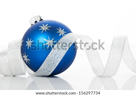 Blue xmas ball and silver ribbon on white background. Merry christmas!