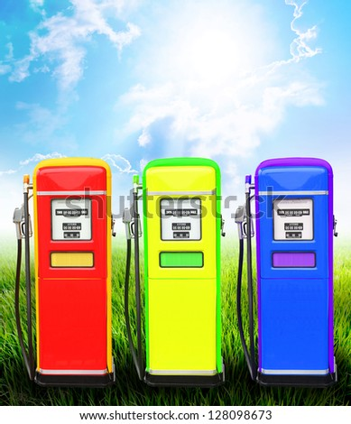 Blue yellow and red gasoline fuel pump ecology concept with landscape background