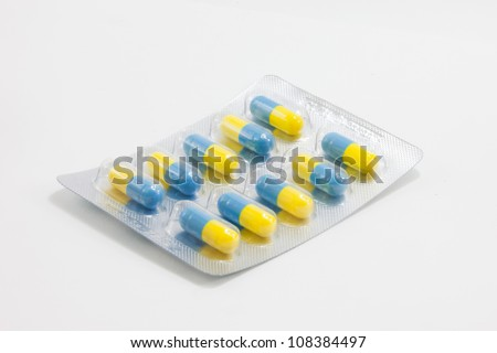 blue-yellow medical capsules in blister package