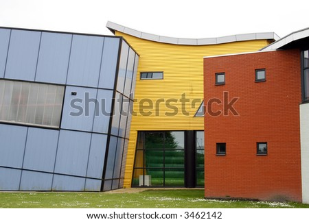 blue, yellow, orange and white colored buildings in different shapes