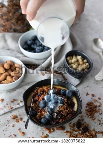 Blueberried Granola with Milk Breakfast Stock fotó ©