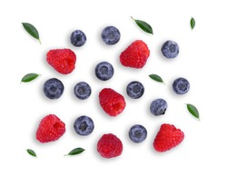 blueberries and raspberries with green leaf solated on white background, top view, flat lay
