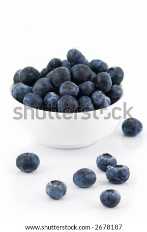 Blueberries and white bowl on white background