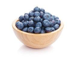 Blueberries in bowl. Isolated on white background
