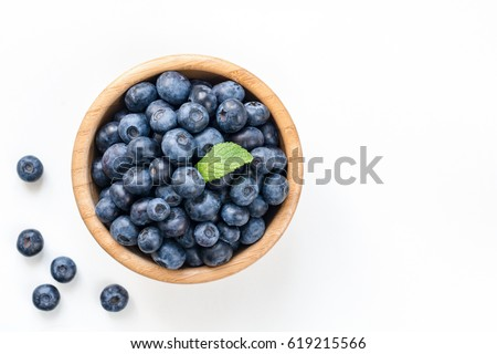 Blueberries in bowl isolated on white background