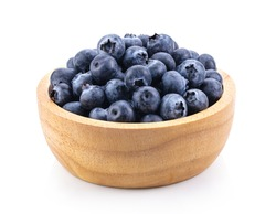 Blueberries in wood bowl  isolated on white background. full depth of field