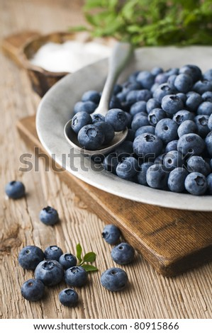 Blueberries on aluminum plate close up shoot