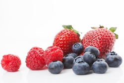 Blueberries, raspberries and strawberries isolated on white background. Sweet summer fruits.