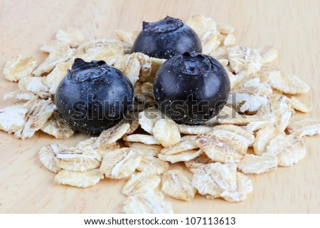 Blueberries with oats on a wooden background. Close up