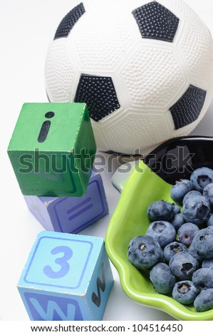 Blueberries with wooden blocks and soccer ball