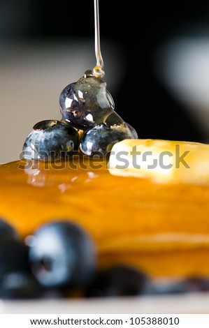 Blueberry butter pancake with honey/ maple syrup flowing down closeup shoot