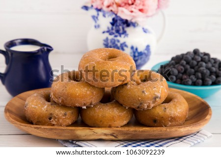Blueberry Cake Donuts on a White Wooden Table