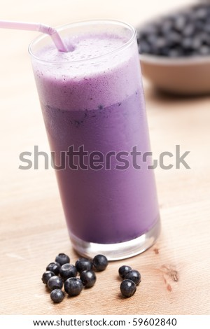 blueberry milk shake on wooden table