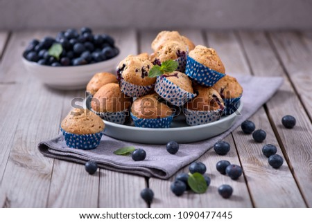 Blueberry muffins, healthy homemade baked dessert with berries