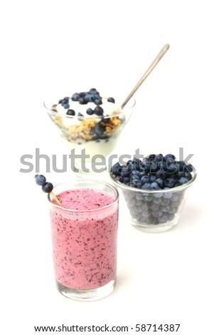 Blueberry smoothie, muesli and fresh fruits - stock photo