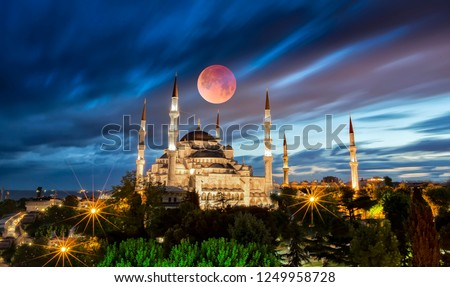 Bluemosque and big moon the night .