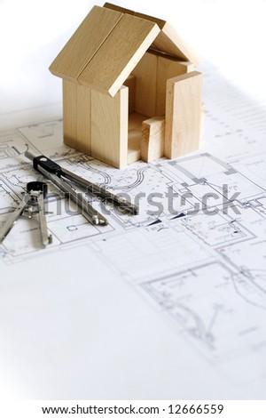 blueprint and wooden model of house