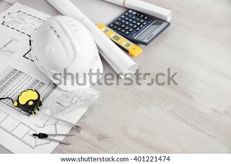 Blueprints and white helmet, close up Stockfoto ©