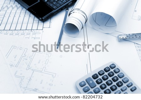 Blueprints background with computer and tools / blue toned - stock photo
