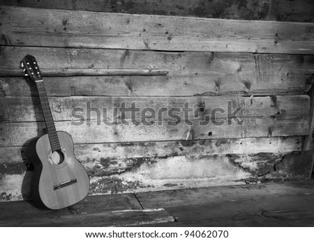 blues guitar the old wooden wall as background horizontal black and white