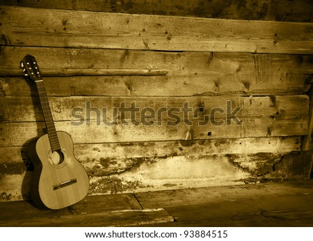 blues guitar the old wooden wall as background horizontal colored