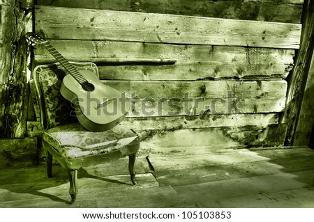 blues guitar the old wooden wall as background horizontal green