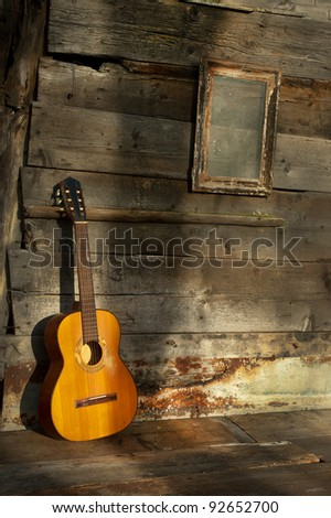 blues guitar the old wooden wall as background vertical