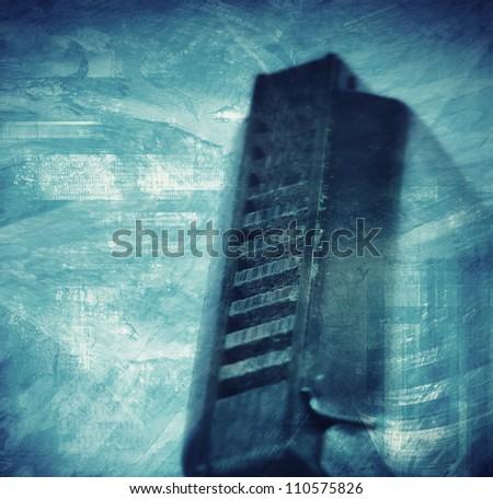 Blues harmonica grunge style textured artistic background
