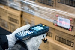 Bluetooth barcode scanner checking goods in the cold room or warehouse.