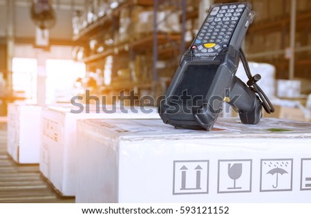 Bluetooth barcode scanner with shipment boxes in warehouse