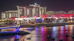 Bluewaters island aerial night timelapse with boats, new walking area with shops and restaurants, newly opened leisure and travel spot in Dubai