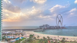 Bluewaters island aerial timelapse during sunset with ferris wheel, new walking area with shopping mall and restaurants, newly opened leisure and travel spot in Dubai