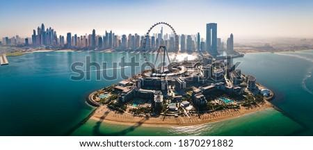 Bluewaters island and Ain Dubai ferris wheel on in Dubai, United Arab Emirates with JBR beach and Dubai marina aerial skyline cityscape view