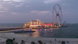 Bluewaters island and JBR aerial day to night transition timelapse with ferris wheel, new walking area with shopping mall and restaurants, newly opened leisure and travel spot in Dubai