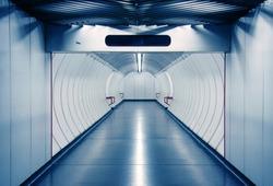 Bluish corridor in a subway