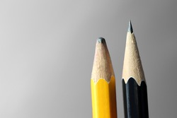 blunt yellow pencil and sharp black pencil