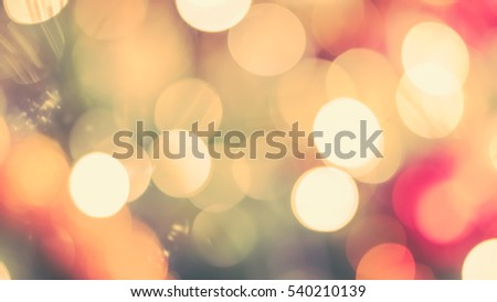 Blur abstract background christmas xmas tree party night light bokeh celebration in warm vintage gold green red yellow orange white tone: Blurry view holiday happiness joy world nightlife concept