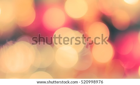 Blur abstract background merry christmas party celebration xmas tree night light bokeh in warm green red yellow orange white sweet tone: Blurry view happy holiday enjoy joy world nightlife concept