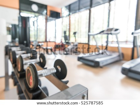 Blur abstract background modern fitness center lifestyle with health exercise equipment: Blurry perspective view gym facility service room: Empty gymnasium indoor space for diet, bodybuilding training