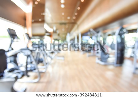 Blur abstract background modern fitness center with health exercise equipment : Blurry perspective view of gym facility service room: Empty gymnasium indoor space for diet, bodybuilding and training